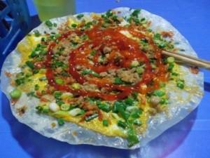Enjoying Roasted Rice Cake in the Middle of Hanoi