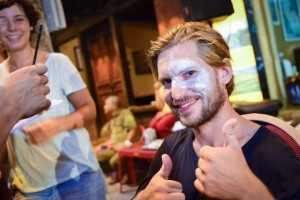 Foreign Tourists Draw Masks On Hanoi Walking Street