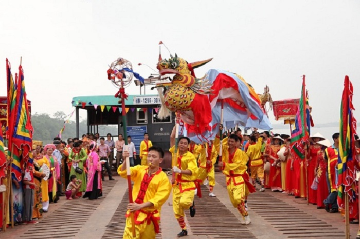 The majestic procession is led by golden-dragon dancers, flag carriers, drummers, an octet of instrument players,