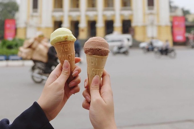 Youngsters eat ice-cream in Winter